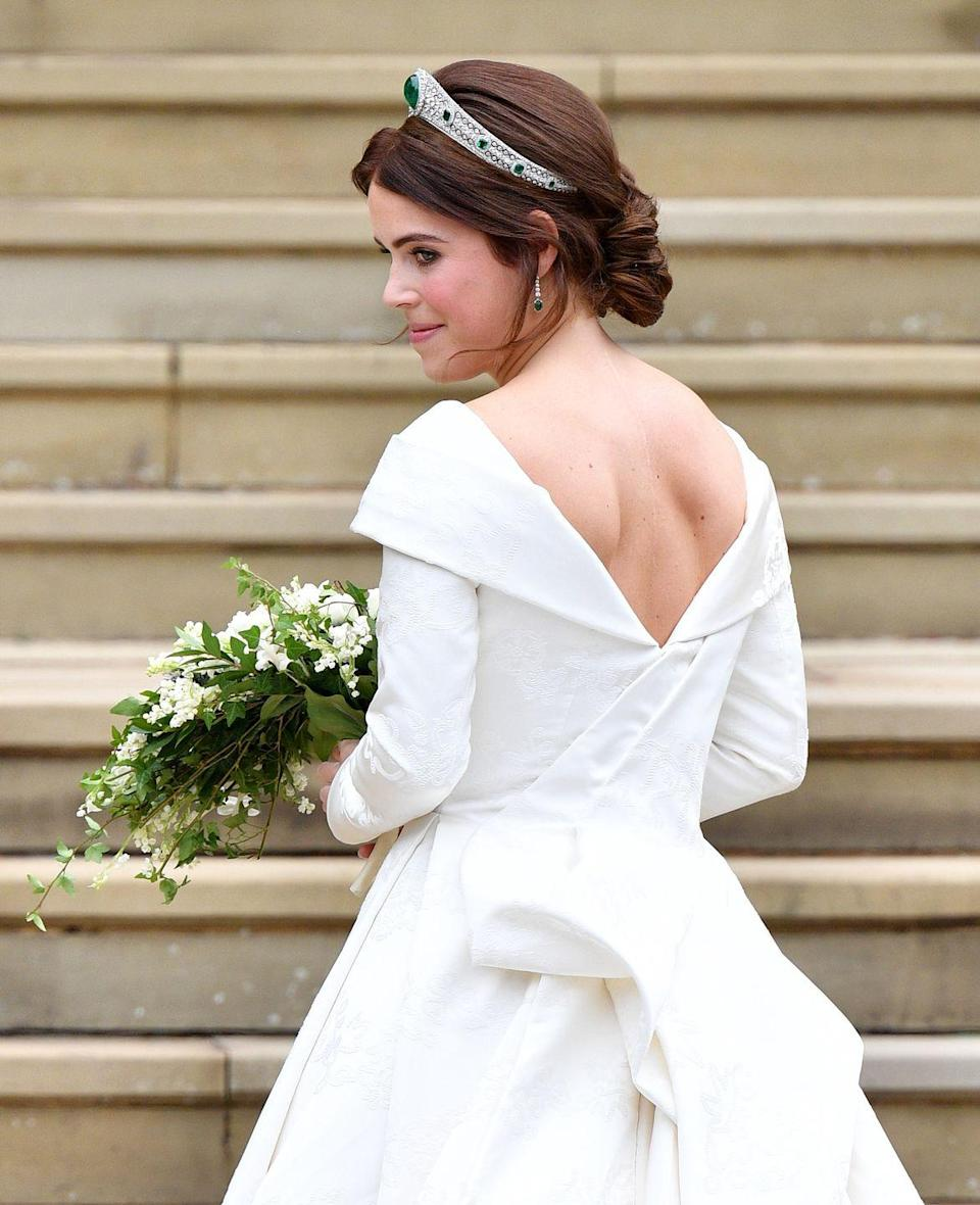 "<p>Princess Eugenie requested a low back on her by dress (designed by Peter Pilotto and Christopher De Vosdress), because as a child she <a href=""https://www.goodhousekeeping.com/health/a22020563/princess-eugenie-scoliosis/"" rel=""nofollow noopener"" target=""_blank"" data-ylk=""slk:suffered from severe scoliosis"" class=""link rapid-noclick-resp"">suffered from severe scoliosis</a> that required an eight-hour surgery after she turned 12, resulting in a scar that's became a part of her identity. <a href=""https://www.goodhousekeeping.com/beauty/fashion/g23722822/princess-eugenie-royal-wedding-dressess/"" rel=""nofollow noopener"" target=""_blank"" data-ylk=""slk:She reportedly"" class=""link rapid-noclick-resp"">She reportedly</a> didn't want to hide it on her wedding day.</p>"