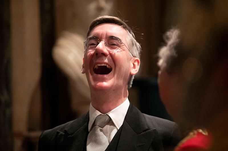 Britain's Leader of the House of Commons Jacob Rees-Mogg laughs whilst talking with someone before the arrival of Britain's Queen Elizabeth II in the Norman Porch at the Palace of Westminster and the Houses of Parliament for the State Opening of Parliament ceremony in London, Britain, October 14, 2019. Matt Dunham/Pool via REUTERS