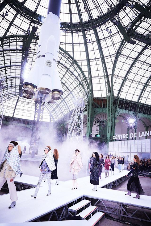 """<p>After a show filled with space-themed references and designs, Karl Lagerfeld """"launched"""" a rocket through the Grand Palais' glass ceiling. </p>"""