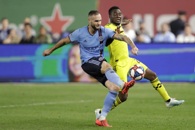 New York City FC defender Maxime Chanot (4) keeps the ball from Columbus Crew midfielder Luis Argudo (2) during the second half of an MLS soccer match, Wednesday, Aug. 21, 2019, in New York. New York City FC defeated Columbus 1-0. (AP Photo/Kathy Willens)