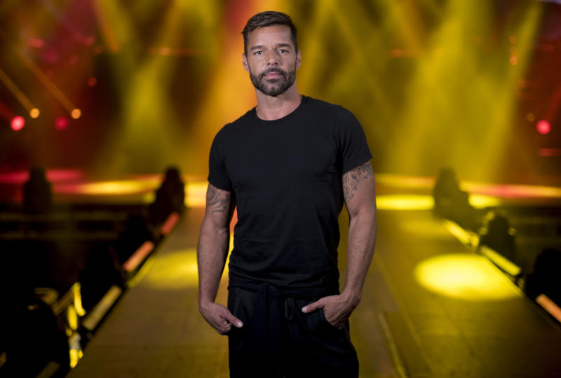 "Puerto Rican singer Ricky Martin, who will perform in concert starting next Feb. 7 at the Puerto Rico Coliseum Jose Miguel Agrelot, poses for a portrait in San Juan, Puerto Rico, Monday, Jan. 27, 2020. ""I'm going to use my music to carry the message of all those who aren't being heard,"" Martin told The Associated Press on Monday while preparing for a concert on his native island. (AP Photo/Carlos Giusti)"