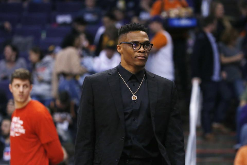 Houston Rockets guard Russell Westbrook leaves the bench area and walks back to the locker room during the first half of an NBA basketball game against the Phoenix Suns, Friday, Feb. 7, 2020, in Phoenix. (AP Photo/Ross D. Franklin)