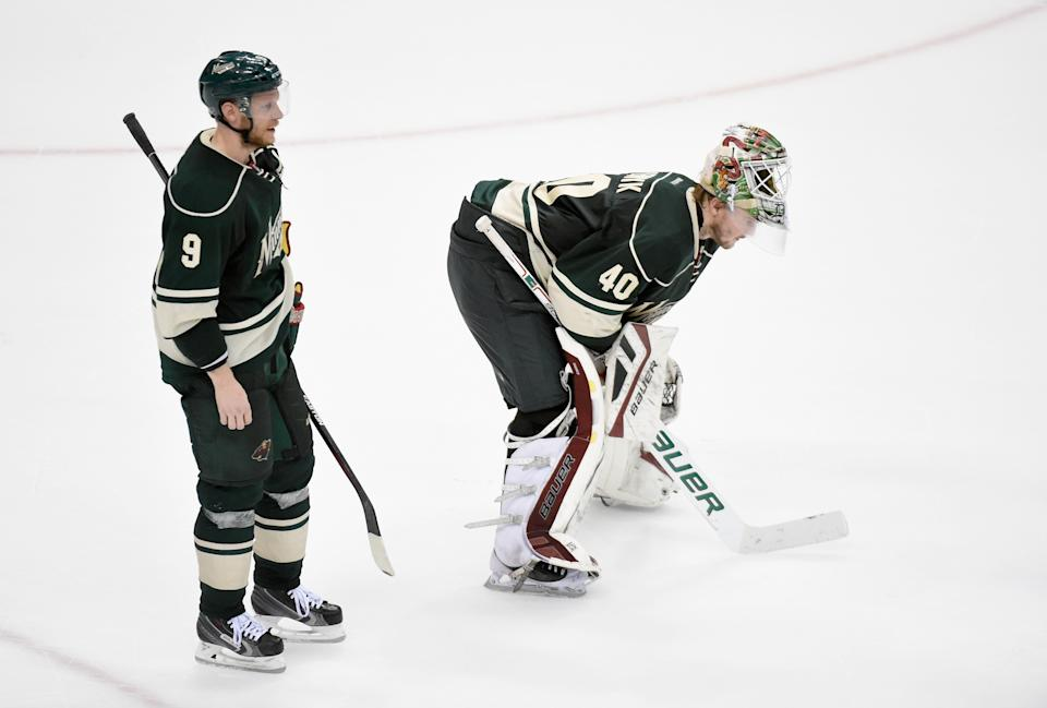 ST PAUL, MN - MAY 7: Mikko Koivu #9 and Devan Dubnyk #40 of the Minnesota Wild react after a loss against the Chicago Blackhawks of Game Four of the Western Conference Semifinals during the 2015 NHL Stanley Cup Playoffs on May 7, 2015 at Xcel Energy Center in St Paul, Minnesota. The Blackhawks defeated the Wild 4-3 to sweep the series. (Photo by Hannah Foslien/Getty Images)