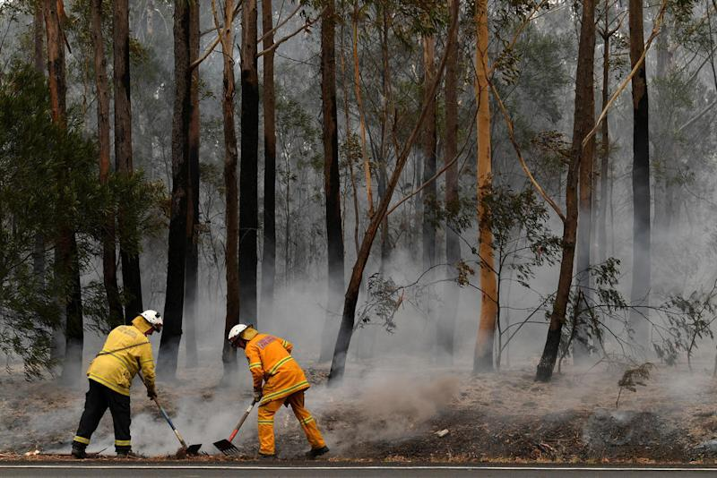 Australian PM Morrison defends response to wildfire crisis as milder conditions signal respite