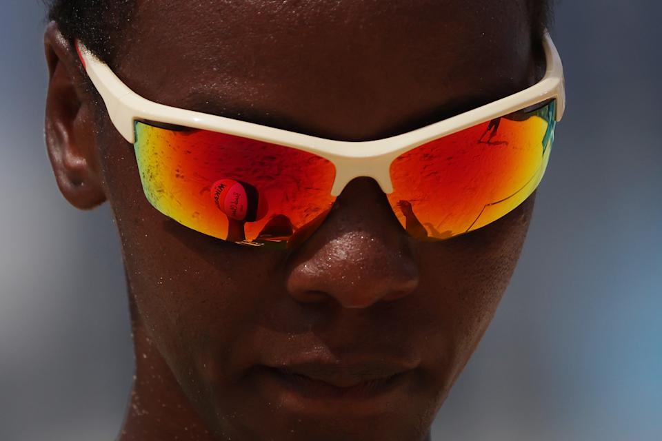 <p>Gaudencia Makokha #1 of Team Kenya looks down between plays against Team United States during the Women's Preliminary - Pool D beach volleyball on day six of the Tokyo 2020 Olympic Games at Shiokaze Park on July 29, 2021 in Tokyo, Japan. (Photo by Sean M. Haffey/Getty Images)</p>