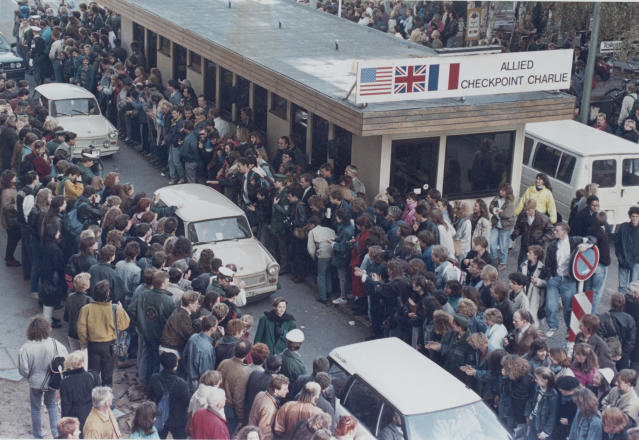 West Germans applaud as East Berlin citizens travel through Checkpoint Charlie on Nov. 10, 1989. (Photo: Reuters)