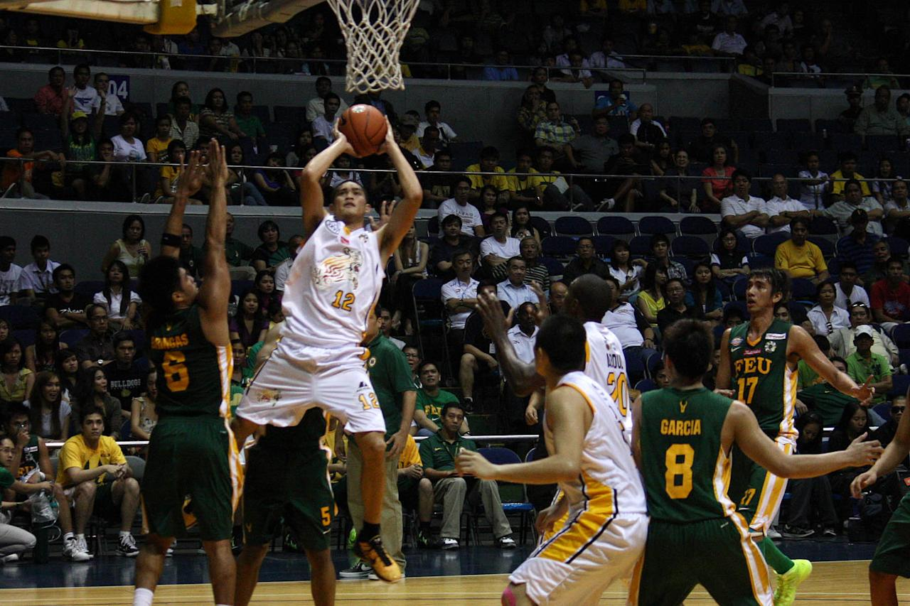 Chris Camus of UST Growling Tigers goes for the basket during the UAAP Season 74 basketball game against FEU Tamaraws at Smart Araneta Coliseum in Quezon City. (Marlo Cueto/NPPA Images)