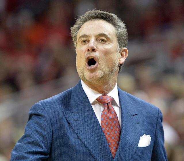Louisville coach Rick Pitino shouts instructions to his team during the first half of an NCAA college basketball game on Sunday, Feb. 16, 2014, in Louisville, Ky. (AP Photo/Timothy D. Easley)