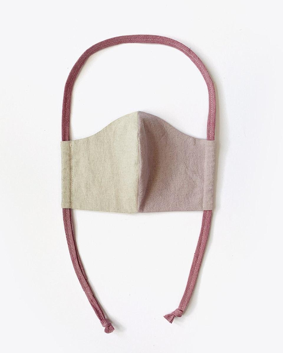 """<h3><a href=""""https://fave.co/38C6u0S"""" rel=""""nofollow noopener"""" target=""""_blank"""" data-ylk=""""slk:Nisolo Upcycled Linen & Cotton Lined Mask"""" class=""""link rapid-noclick-resp"""">Nisolo Upcycled Linen & Cotton Lined Mask</a></h3><br>Handmade by the local Nashville artist behind the apparel company <a href=""""https://emleedesign.com/"""" rel=""""nofollow noopener"""" target=""""_blank"""" data-ylk=""""slk:Emlee"""" class=""""link rapid-noclick-resp"""">Emlee</a>, these masks feature a trendy <a href=""""https://www.refinery29.com/en-us/two-tone-color-trend"""" rel=""""nofollow noopener"""" target=""""_blank"""" data-ylk=""""slk:two-tone pattern"""" class=""""link rapid-noclick-resp"""">two-tone pattern</a> cut to fit your face. Each mask is hand-sewn by local seamstresses using deadstock linen, cotton, and hemp fabrics and lined with 100% USA-made cotton twill for comfort.<br><br><strong>Nisolo</strong> Upcycled Linen & Cotton Lined Mask, $, available at <a href=""""https://go.skimresources.com/?id=30283X879131&url=https%3A%2F%2Ffave.co%2F38C6u0S"""" rel=""""nofollow noopener"""" target=""""_blank"""" data-ylk=""""slk:Nisolo"""" class=""""link rapid-noclick-resp"""">Nisolo</a>"""