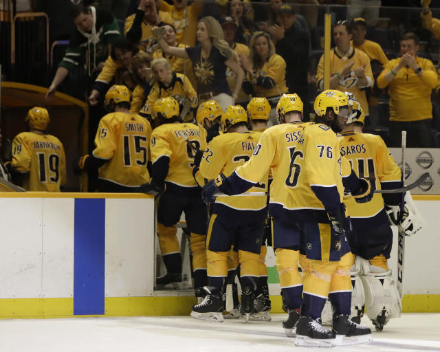 Nashville Predators players leave the ice following Game 7 of an NHL hockey second-round playoff series against the Winnipeg Jets on Thursday, May 10, 2018, in Nashville, Tenn. The Jets won 5-1, and advanced to the Western Conference final. (AP Photo/Mark Humphrey)