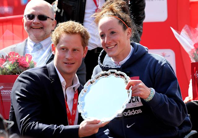 LONDON, ENGLAND - APRIL 21: Womens Elite Wheelchair winner Tatyana McFadden of USA receives her trophy from Prince Harry following the Virgin London Marathon 2013 on April 21, 2013 in London, England. (Photo by Chris Jackson/Getty Images)