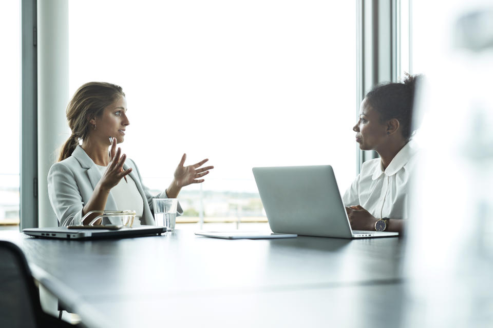 Businesswomen having discussion in conference room