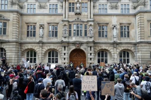 """Protesters chant """"Take it down!"""" and """"Decolonise!"""", and held placards urging """"Rhodes Must Fall"""" and """"Black Lives Matter"""" in front of the imperialist's statue at Oxford's Oriel College"""