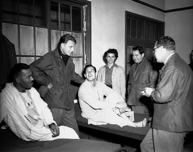 <p>Billy Graham, second from left, visits service personnel at the 21st Evacuation Hospital in Pusan, Korea, on Dec. 21, 1952, during a tour of U.N. bases in the Far East. (Photo: AP) </p>