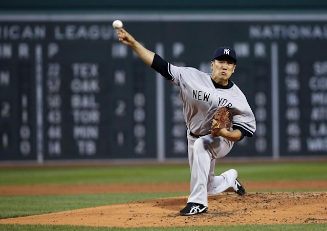New York Yankees starting pitcher Masahiro Tanaka delivers to the Boston Red Sox during the first inning of a baseball game at Fenway Park in Boston, Tuesday, April 22, 2014. (AP Photo/Elise Amendola)