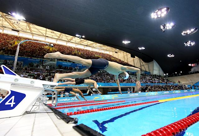 LONDON, ENGLAND - JULY 28: Sun Yang of China dives off of the starting block as he competes in heat four of the Men's 400m Freestyleon Day One of the London 2012 Olympic Games at the Aquatics Centre on July 28, 2012 in London, England. (Photo by Al Bello/Getty Images)
