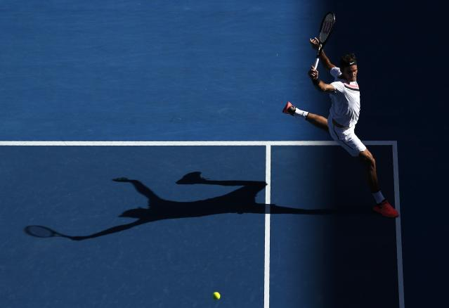 Tennis - Australian Open - Rod Laver Arena, Melbourne, Australia, January 22, 2018. Roger Federer of Switzerland hits a shot against Marton Fucsovics of Hungary. REUTERS/Edgar Su TPX IMAGES OF THE DAY