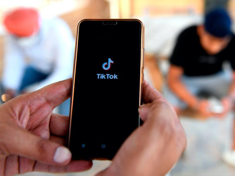 TikTok users react to Trump's ban (AFP via Getty Images)