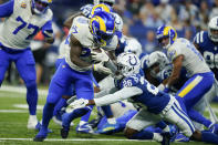 Los Angeles Rams' Darrell Henderson (27) is tackled by Indianapolis Colts' Rock Ya-Sin (26) during the second half of an NFL football game, Sunday, Sept. 19, 2021, in Indianapolis. (AP Photo/Michael Conroy)