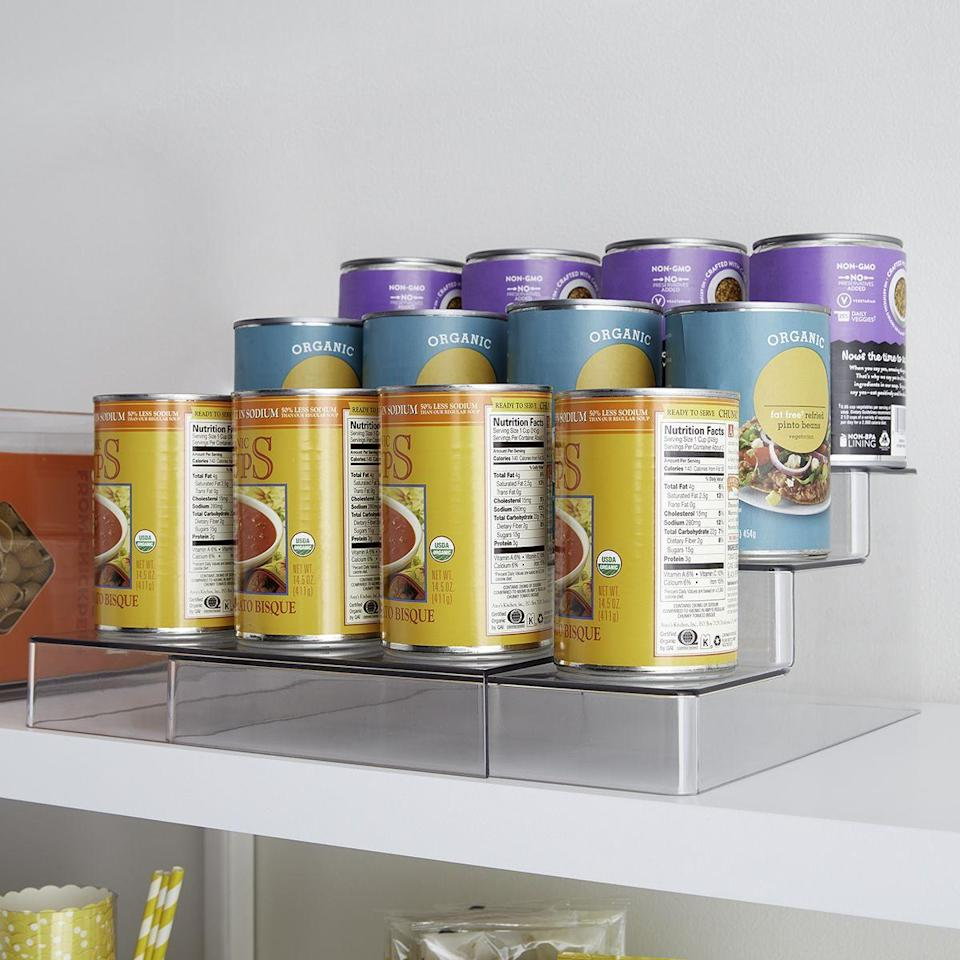 """<p><strong>The Home Edit</strong></p><p>containerstore.com</p><p><strong>$29.99</strong></p><p><a href=""""https://go.redirectingat.com?id=74968X1596630&url=https%3A%2F%2Fwww.containerstore.com%2Fcategory%2FtheHomeEditExclusiveCollection%3FproductId%3D11010521&sref=https%3A%2F%2Fwww.countryliving.com%2Fhome-maintenance%2Forganization%2Fg34032194%2Fthe-home-edit-organizers%2F"""" rel=""""nofollow noopener"""" target=""""_blank"""" data-ylk=""""slk:Shop Now"""" class=""""link rapid-noclick-resp"""">Shop Now</a></p><p>Rule of thumb: When you don't see it, you don't use it. This three-tier shelf can hold bigger cans, making them easier to reach when cooking.</p>"""
