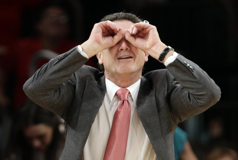 This photo taken March 15, 2013, shows Louisville head coach Rick Pitino gesturing to his team during the second half of an NCAA college basketball game against the Notre Dame at the Big East Conference tournament in New York. The Cardinals have shown that they're comfortable being front-runners in their season-long quest to go further than last year's Final Four appearance. Now, they enter the NCAA tournament as the overall No 1 seed. (AP Photo/Frank Franklin II)