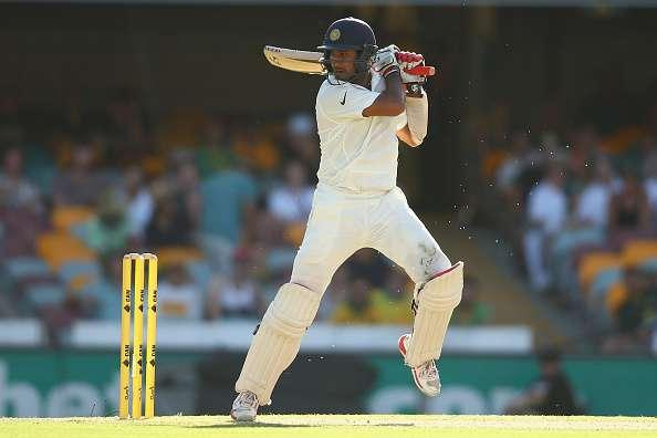 BRISBANE, AUSTRALIA - DECEMBER 19: Cheteshwar Pujara of India bats during day three of the 2nd Test match between Australia and India at The Gabba on December 19, 2014 in Brisbane, Australia. (Photo by Cameron Spencer/Getty Images)