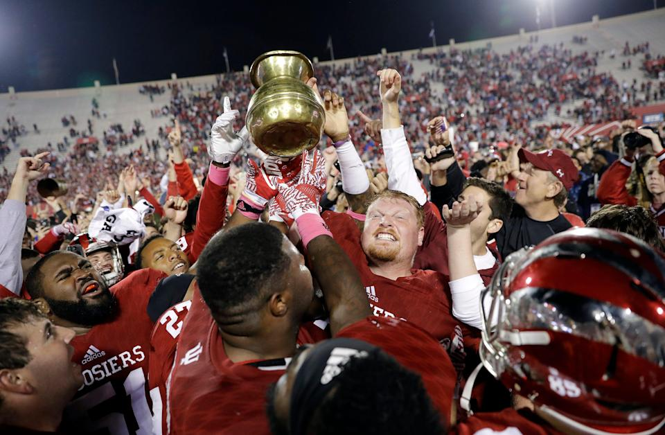 Indiana players celebrate with the Old Brass Spittoon in 2016 after MSU's 24-21 loss in overtime at Indiana.