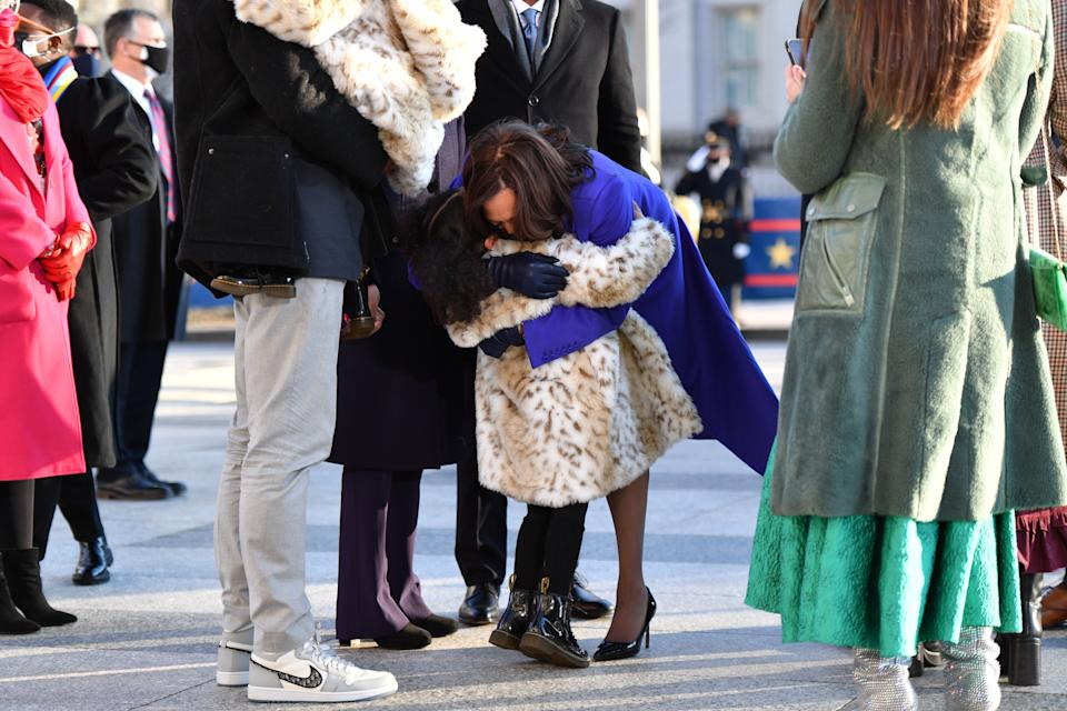 Harris hugs her great-niece Amara before walking the parade route with her family.Ajagu's shoes are visible on the left. (Photo: Mark Makela via Getty Images)
