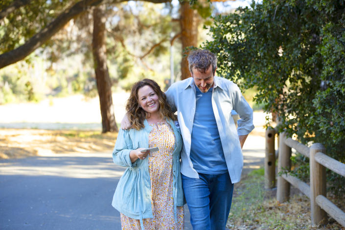 Melissa McCarthy and Chris O'Dowd walk outside in a scene from The Starling.  Image via Netflix