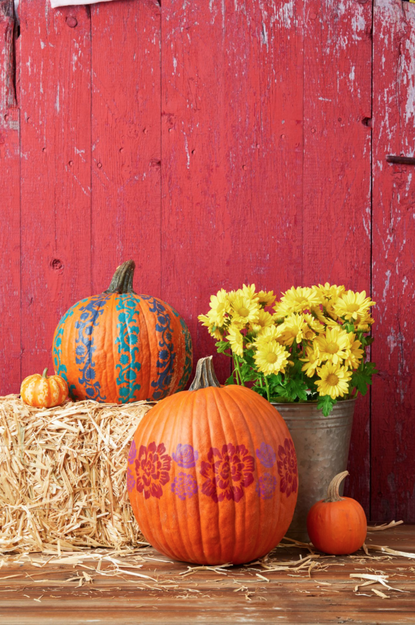 """<p>Thick stripes—either vertical or horizontal—transform pumpkins into fun, bold statement pieces. </p><p><strong> Make the pumpkins:</strong></p><p>Use painter's tape to outline several stripes (or one horizontal stripe) around an orange pumpkin. </p><p><strong>To make vertical stripes:</strong> Tape a flower stencil inside one of the stripes. Using a foam pouncer, lightly dab paint onto the pumpkin to fill in the stencil. Let dry, then remove the stencil and tape it to the next section of the stripe. Continue until you fill in the entire stripe, then repeat for the other stripes, alternating colors.</p><p><strong>To make a horizontal stripe: </strong>Cut out a large flower stencil and tape it inside the stripe. Using the pouncer, lightly dab paint onto the pumpkin to fill in the stencil. Let dry, then remove the stencil and use it several more times within the stripe. Repeat with two smaller stencils.</p><p><a class=""""link rapid-noclick-resp"""" href=""""https://go.redirectingat.com?id=74968X1596630&url=https%3A%2F%2Fwww.walmart.com%2Fip%2FFolkArt-5070E-Acrylic-Craft-Paint-Set-Matte-Finish-Festival-Set-of-12-24-fl-oz%2F52620447&sref=https%3A%2F%2Fwww.thepioneerwoman.com%2Fholidays-celebrations%2Fg32894423%2Foutdoor-halloween-decorations%2F"""" rel=""""nofollow noopener"""" target=""""_blank"""" data-ylk=""""slk:SHOP CRAFT PAINT"""">SHOP CRAFT PAINT </a></p>"""