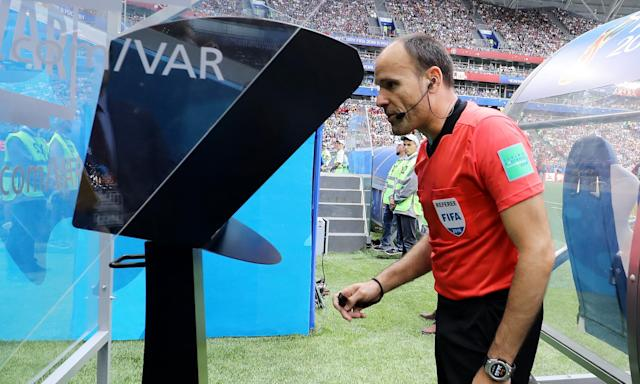 Referee Antonio Mateu reviews VAR footage before awarding Australia a penalty in their Group C game against Denmark.