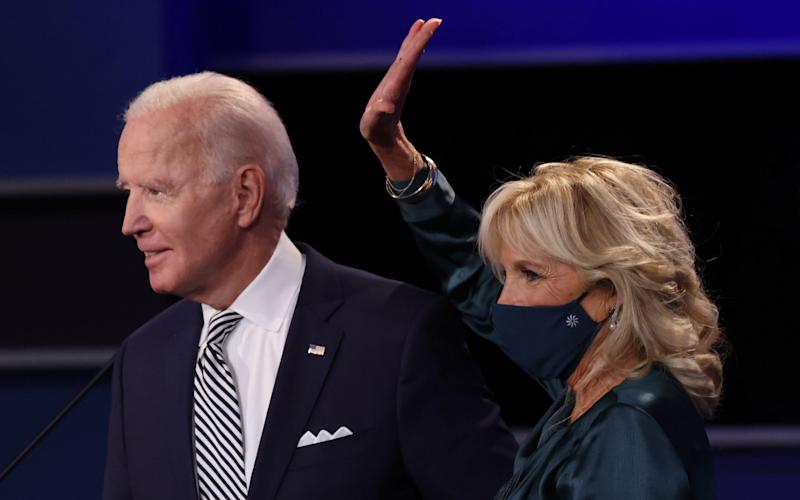 Democratic presidential nominee Joe Biden and his wife Jill Biden wave to the audience after the first presidential debate against U.S. President Donald Trump at the Health Education Campus of Case Western Reserve University on September 29, 2020 in Cleveland, Ohio. This is the first of three planned debates between the two candidates in the lead up to the election on November 3 - GETTY IMAGES