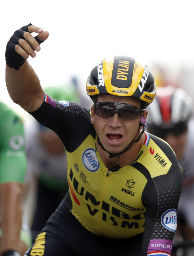 Netherlands' Dylan Groenewegen celebrates as he crosses the finish line to win the seventh stage of the Tour de France cycling race over 230 kilometers (142,9 miles) with start in Belfort and finish in Chalon sur Saone, France, Friday, July 12, 2019. (AP Photo/Christophe Ena)