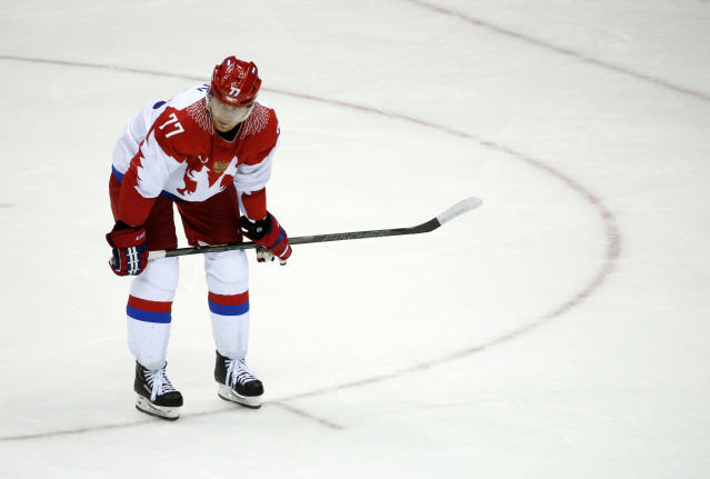 Russia defenseman Anton Belov reacts at the end of a men's quarterfinal ice hockey game against Russia at the 2014 Winter Olympics, Wednesday, Feb. 19, 2014, in Sochi, Russia. Finland won 3-1. (AP Photo/Mark Humphrey)