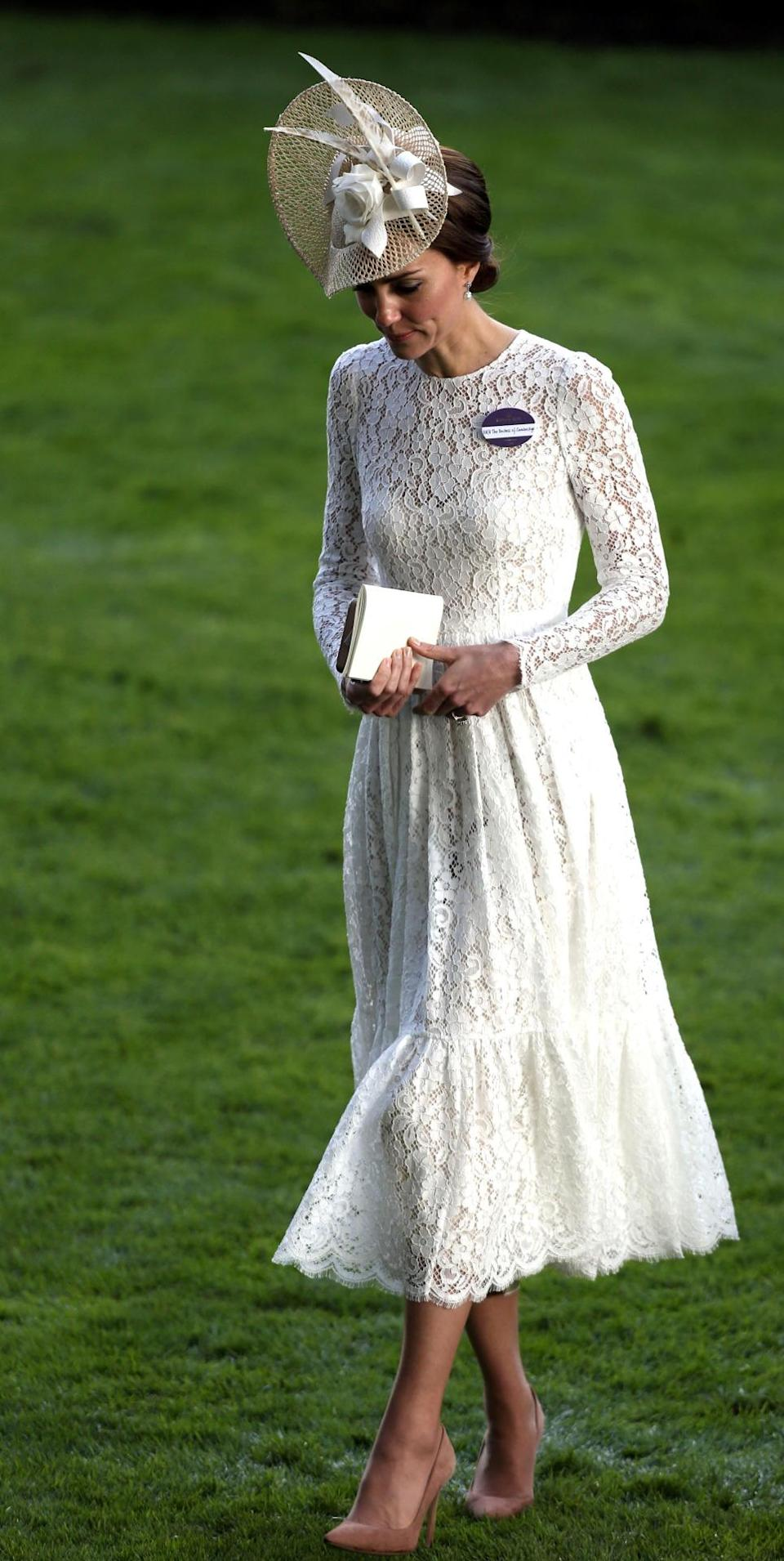 <p>For a Royal Ascot outing, Kate wore a romantic lace dress by Italian duo Dolce & Gabbana. An elegant hat and suede heels accessorised her My Fair Lady look.</p><p><i>[Photo: PA]</i></p>