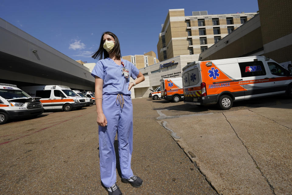 Anne Sinclair, a pediatric emergency room nurse at the University of Mississippi Medical Center, in Jackson, stands in the middle of the filled ambulance bay and wonders why some incoming patients and their parents have to be reminded to wear masks when they come to the hospital, Wednesday, Aug. 25, 2021. A mother of two young children, Sinclair is tired of the covid misinformation she deals with having seen children in her unit die of the virus. (AP Photo/Rogelio V. Solis)