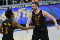 Cleveland Cavaliers' Kevin Love, right, celebrates with Collin Sexton after Sexton scored during the second half of the team's NBA basketball game against the Boston Celtics, Wednesday, May 12, 2021, in Cleveland. The Cavaliers won 102-94. (AP Photo/Tony Dejak)
