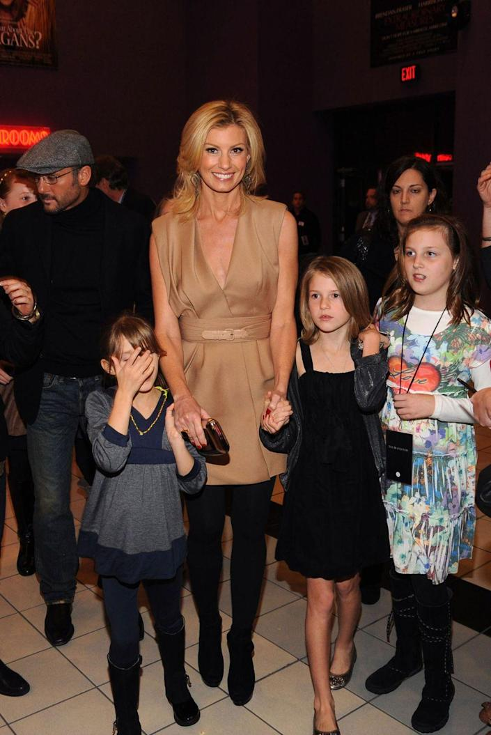 <p>Faith Hill's daughter Maggie, the middle daughter of three, was born in 1998. In this photo, taken in 2009, she's to the right of her mom (in the black dress). </p>
