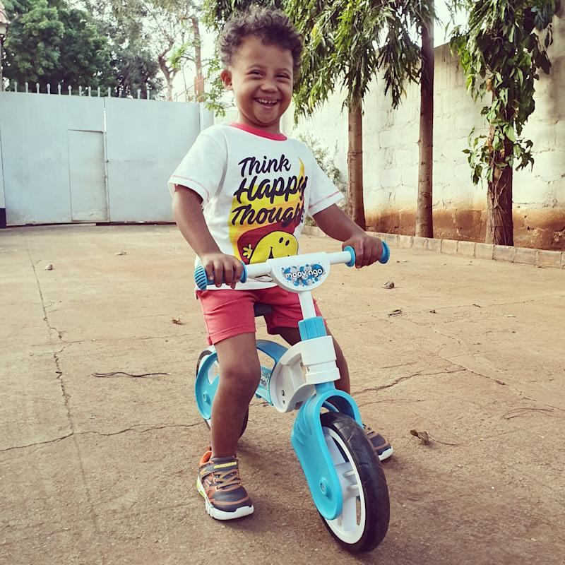 Hayley's son riding a tricycle.