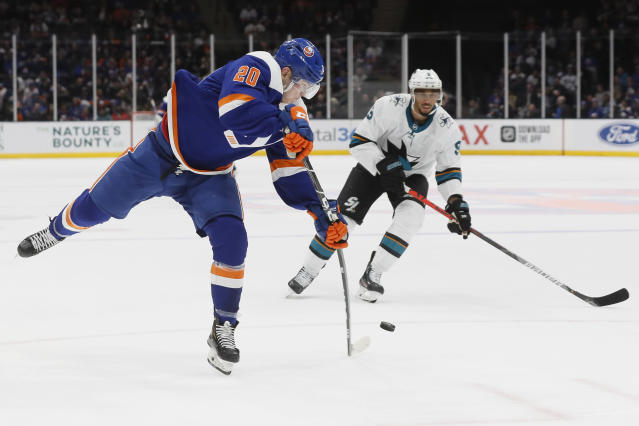 New York Islanders left wing Kieffer Bellows (20) takes a shot on goal during the second period of an NHL hockey game against the San Jose Sharks, Sunday, Feb. 23, 2020, in Uniondale, NY. (AP Photo/John Minchillo)