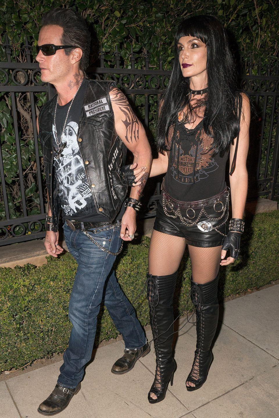 """<p>For their 2015 couples costume, <a href=""""https://www.womenshealthmag.com/beauty/g33844057/cindy-crawford-makeup-free/"""" rel=""""nofollow noopener"""" target=""""_blank"""" data-ylk=""""slk:Cindy"""" class=""""link rapid-noclick-resp"""">Cindy</a> and Rande dressed up as Hell's Angels in Beverly Hills, California. (Anyone else getting major <em>Sons of Anarchy</em> nostalgia?)</p>"""