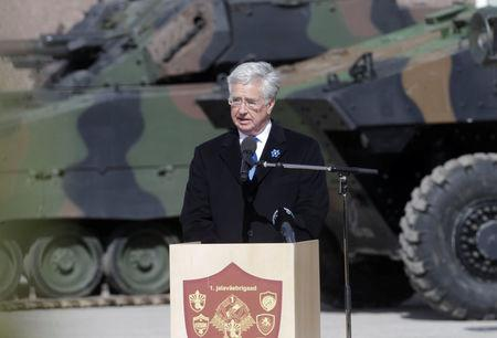 Britain's Defence Secretary Michael Fallon speaks during the official ceremony welcoming the deployment of a multi-national NATO battalion in Tapa