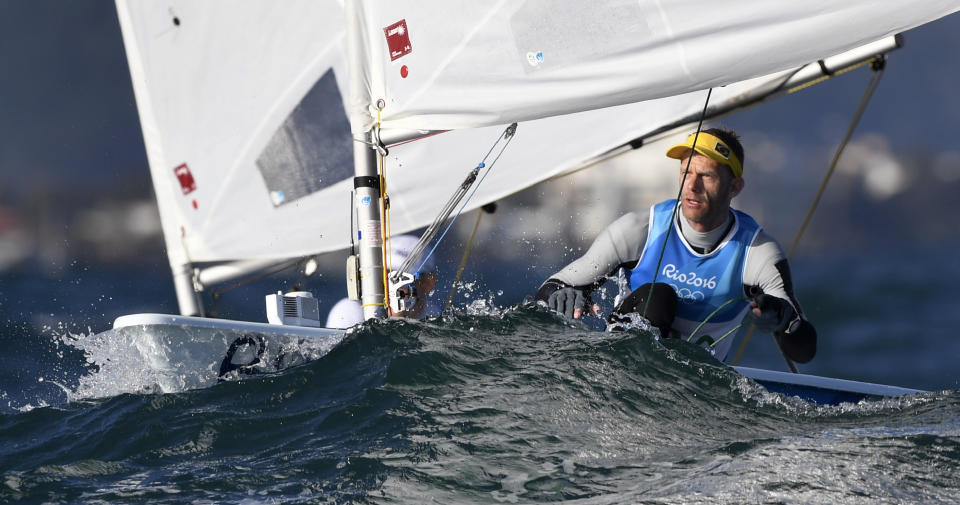 Brazil's Robert Scheidt competes in the Laser Men sailing class on Guanabara Bay in Rio de Janerio during the Rio 2016 Olympic Games on August 13, 2016. / AFP / WILLIAM WEST        (Photo credit should read WILLIAM WEST/AFP via Getty Images)