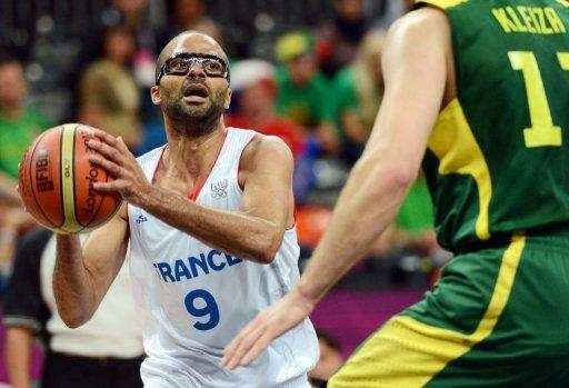 Tony Parker (left) vies with Lithuanian forward Linas Kleiza