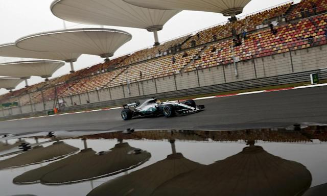 """<span class=""""element-image__caption"""">Lewis Hamilton steers his Mercedes around a wet Shanghai International Circuit during Friday's first practice session for the Chinese Grand Prix.</span> <span class=""""element-image__credit"""">Photograph: Andy Wong/AP</span>"""