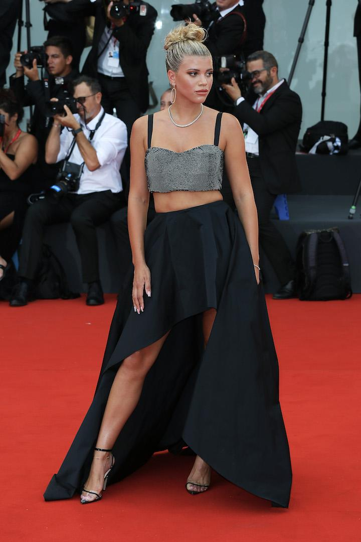 Styled by Jill Jacobs, Sofia Richie stole the spotlight in a sequinned crop top and asymmetric skirt by Twinset. <em>[Photo: Getty]</em>