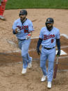 Minnesota Twins's Jake Cave, left, celebrates after scoring on a balk by Cincinnati Reds pitcher Sonny Gray who was throwing to Twins' Marwin Gonzalez during the fifth inning of a baseball game Sunday, Sept. 27, 2020, in Minneapolis. (AP Photo/Craig Lassig)
