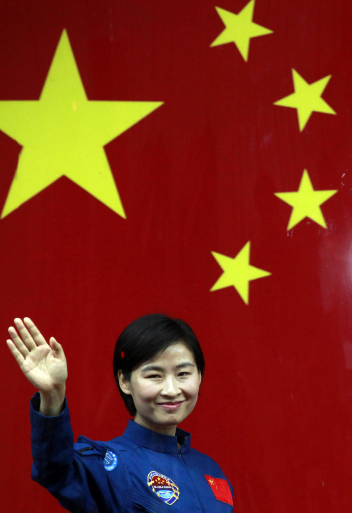 FILE - In this file photo taken Friday, June 15, 2012, Liu Yang, China's first woman astronaut waves as she leaves after attending a meet the press event at the Jiuquan satellite launch center near Jiuquan in western China's Gansu province. A glance at history suggests it's easier for a Chinese woman to orbit Earth than to land a spot on the highest rung of Chinese politics. In June, the 33-year-old Air Force major marked a major feminist milestone by becoming the first Chinese woman to travel in space. With a once-a-decade leadership transition set to kick off Nov. 8, many now are waiting to see if another ambitious Chinese female, State Councilor Liu Yandong, can win one of the nine spots at the apex of Chinese power.(AP Photo/Ng Han Guan, File)