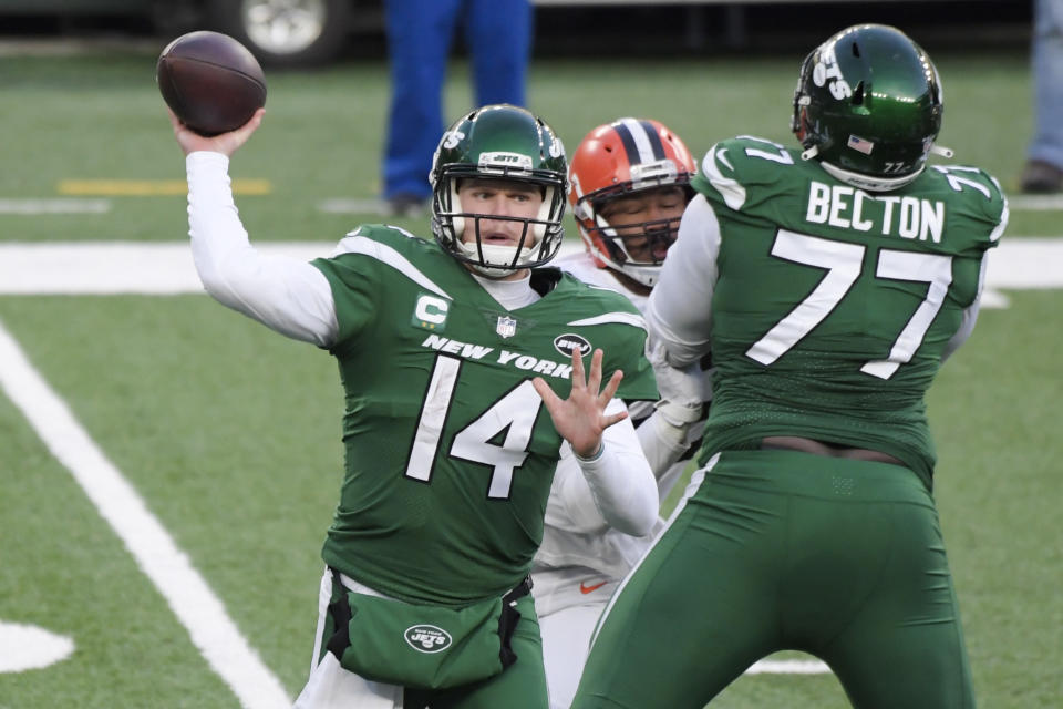 New York Jets quarterback Sam Darnold (14) throws a pass during the second half of an NFL football game as offensive tackle Mekhi Becton (77) blocks Cleveland Browns' Myles Garrett, Sunday, Dec. 27, 2020, in East Rutherford, N.J. (AP Photo/Bill Kostroun)
