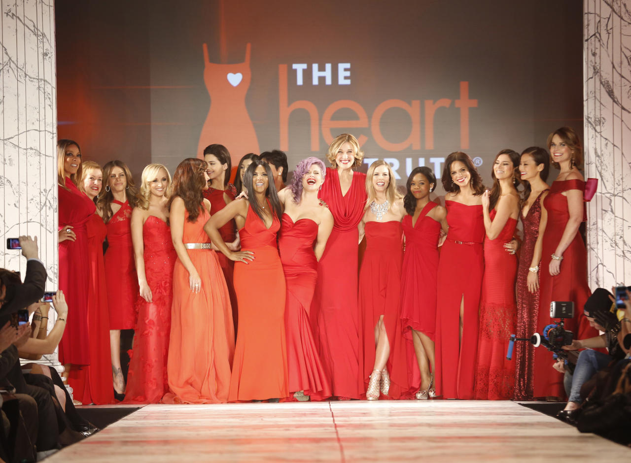 Participants finish the Red Dress Collection 2013 Fashion Show, on Wednesday, Feb. 6, 2013 in New York. (Photo by John Minchillo/Invision/AP)